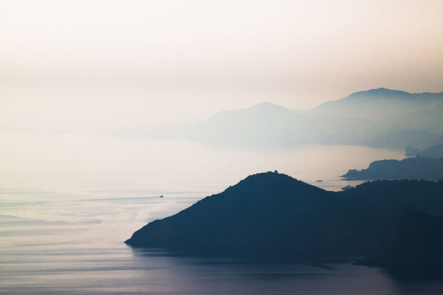 Distant Distant Mountains Distant Background Mountains Sky Sky And Clouds Sea Sea And Sky Seascape Blue Ocean Minimalism Minimal Fine Art Photography