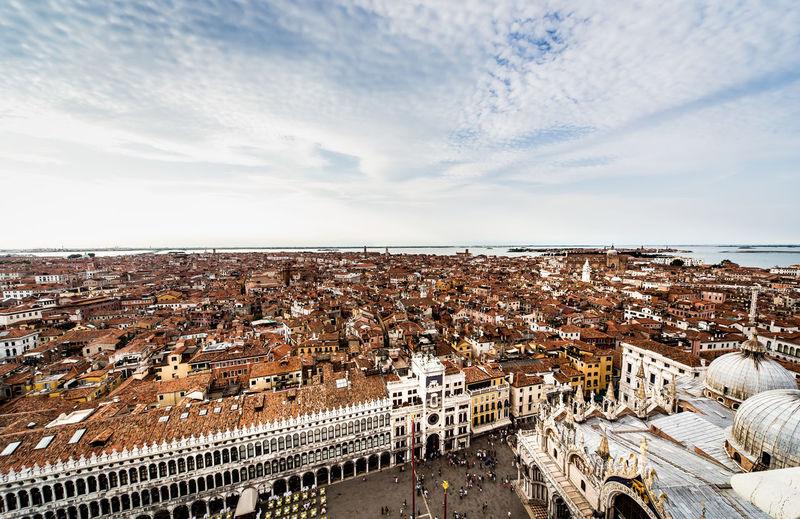 Saint marks basilica by townscape against sky