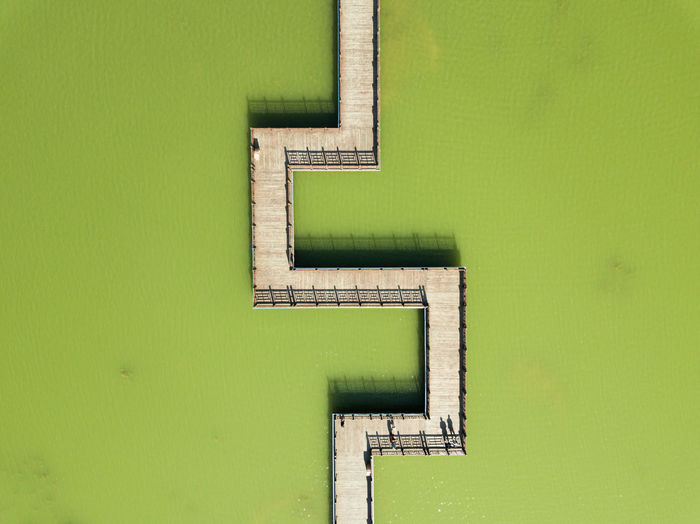 Low angle view of green wall against building