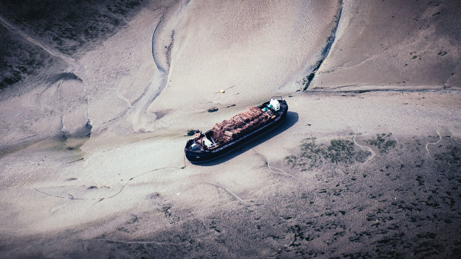 High angle view of boat moored on beach