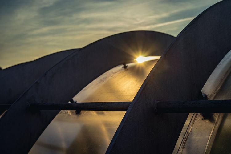Close-up of bridge against sky during sunset