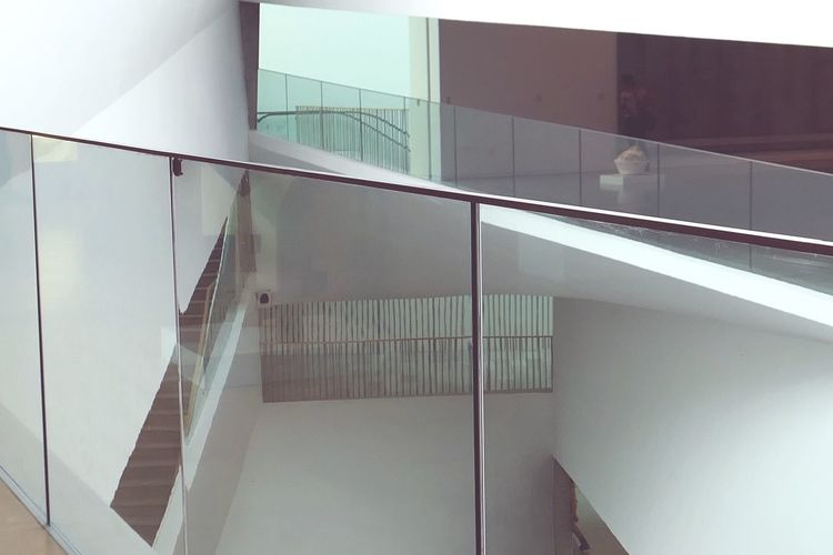 Indoors  Architecture Built Structure Building No People Low Angle View Staircase Steps And Staircases Railing Modern White Color Reflection Glass - Material Day Pattern Close-up