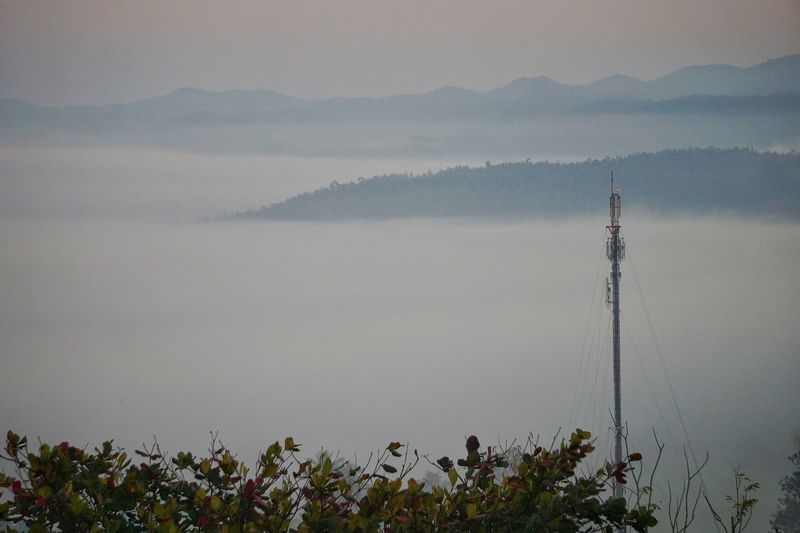 The Telecom Tower is high above the mist covering the city below. Tree Village Urban Environment Landscape Beautiful Countryside Town City Mountain Autumn Cloud Sky Vacation Technology Tower Cellphone Telephone Pole Communication Telecom 3g 4g Covered Mist Fog