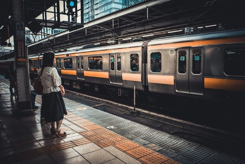 Transportation Railroad Station Platform Railroad Track Public Transportation Train - Vehicle Railroad Station Rail Transportation Journey Full Length Passenger Mode Of Transport Casual Clothing Lifestyles City Life Travel One Person Subway Train Real People Standing Indoors