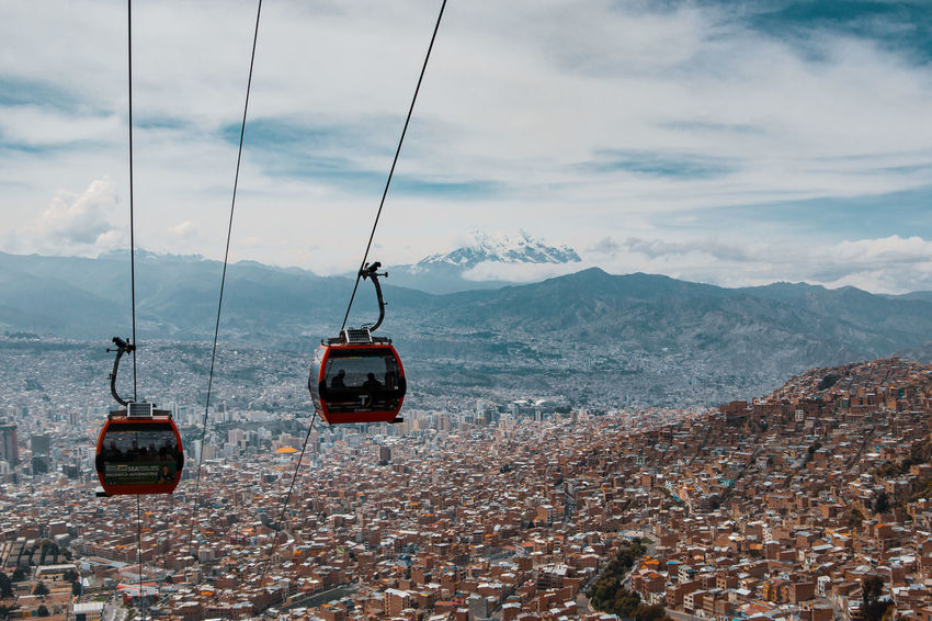 Going up to El Alto. A city that lies 4,150m over sea level. La Paz and El Alto are connected by a cable car made by an Austrian company. The city is also accessible by a steep and dangerous road. A car wreck that hangs inbetween the cliffs should be enough of a sign. City Cityscape El Alto Latin America Public Transportation Transportation Cable Cable Car Crowd Day Environment Group Of People Mode Of Transportation Mountain Mountain Range Outdoors Overhead Cable Car Scenics - Nature Ski Lift Snow Snowcapped Mountain South America Travel Travel Destinations Urbex The Traveler - 2018 EyeEm Awards