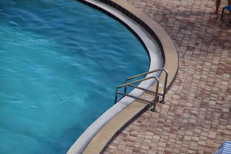 High Angle View Of Ladder On Pool At Tourist Resort