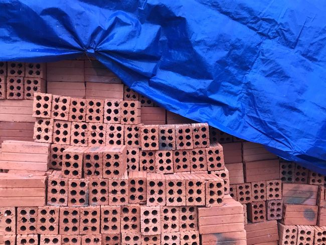 Red bricks and blue tarpaulin Outdoors Construction Site Blue Tarpaulin Red Bricks No People Blue Day Close-up