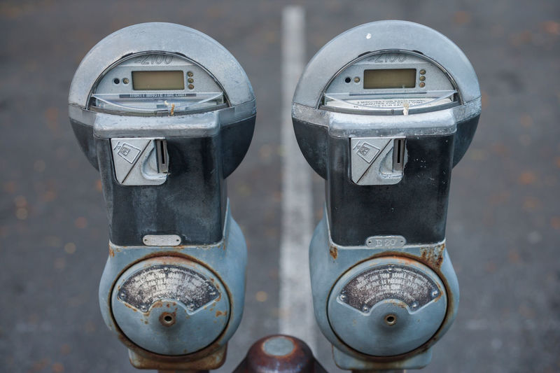 Close-up Group Of Objects Hanging Out Man Made Object No People Parking Meter Two Parking Mete