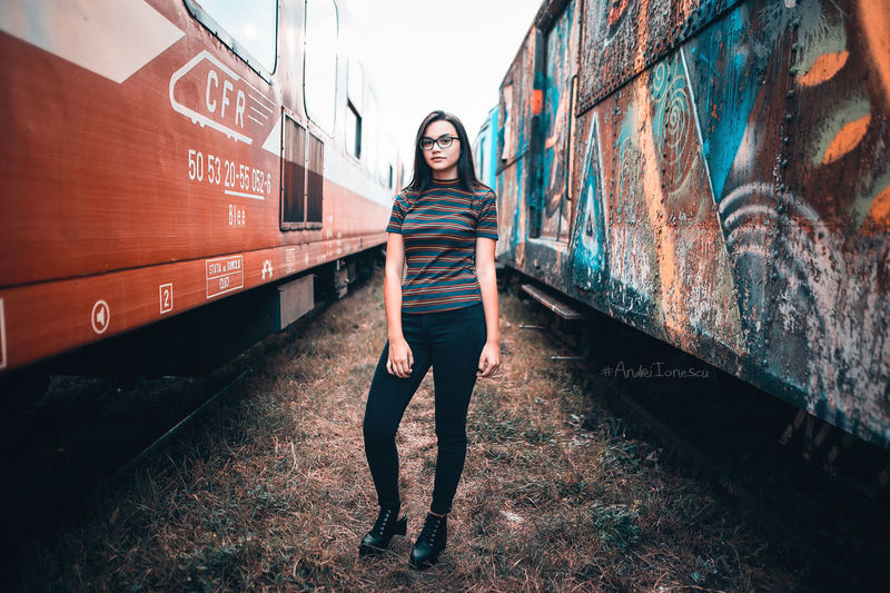 Building Exterior Built Structure Casual Clothing Day Front View Full Length Graffiti Long Hair Looking At Camera Outdoors Person Standing Train Train Station Wall - Building Feature