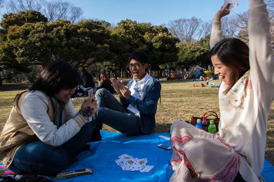 Adult Asian  Bonding Celebration Celebratory Toast Cheerful Emotions Enjoyment Excited Friendship Fun Happiness Japan Outdoors Party - Social Event People Picnic Portable Information Device Smiling Social Gathering Togetherness Uniqueness Winner Young Adult Young Women