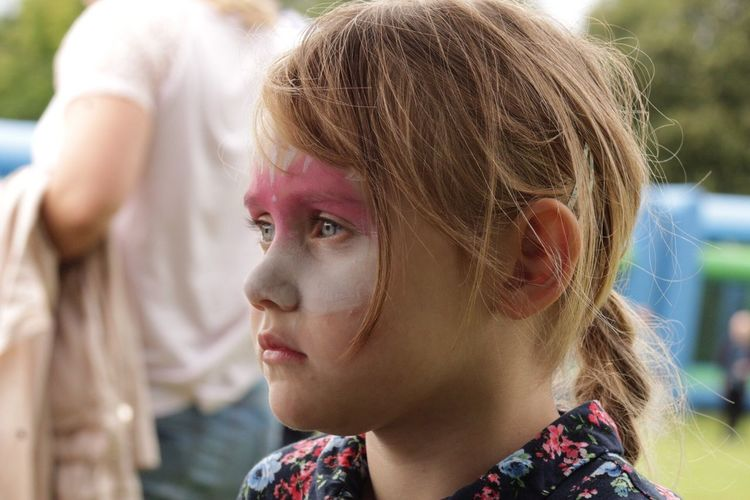 Close-up of girl with paint on face
