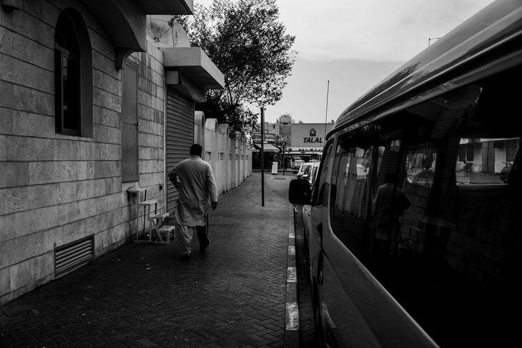 Street Photos, Architecture Blackandwhite Building Exterior Dubai, Lifestyles Monochrome Photography Monochrome Streetphotography Real People Rear View Street Life, Streetphotography Transportation Walking
