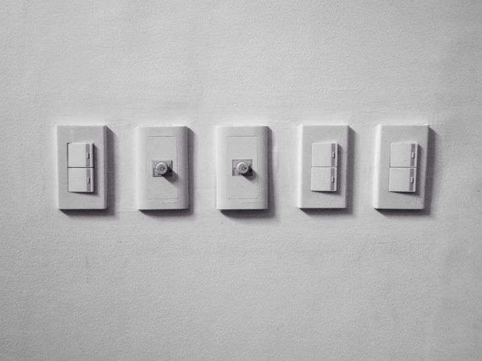 Close-Up Of Light Switch On Wall