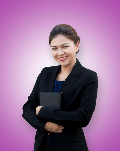 Asia business woman crossed arms with book portrait Asian  Isolated Office Smart Thai Work Arms Crossed Background Book Business Businesswoman Color Confidence  Happiness Looking At Camera Manager Notebook Portrait Pretty Professional Smiling Studio Shot Style Success Suit