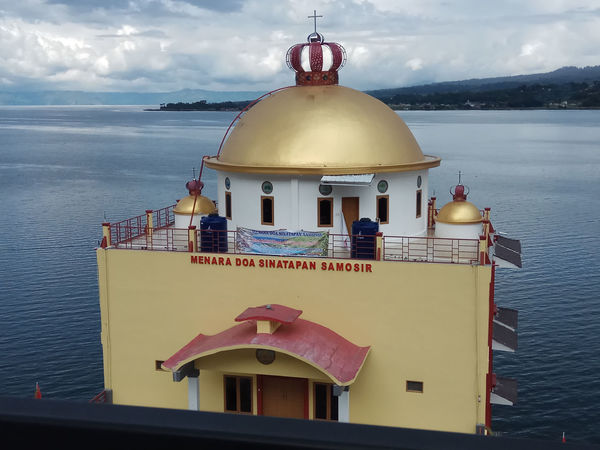 Place of worship - Sinatapan Samosir Architecture Belief Building Building Exterior Built Structure Cloud - Sky Nature Outdoors Place Of Worship Religion Sea Sky Spirituality Travel Destinations Water
