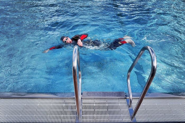 Triathlete Water Swimming Pool Swimming Underwater Leisure Activity High Angle View One Person Real People Lifestyles Outdoors Sea Nature Day Adults Only People Adult Only Men One Man Only Triathlete