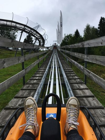 Bobsled track Bobsled Personal Perspective Shoe Converse Human Foot Cloud - Sky Fun Railroad Track Outdoors Sky Mountain Travel Destinations Scenics One Person Nature Adventure
