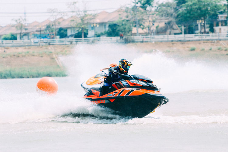 People riding motor boat in water