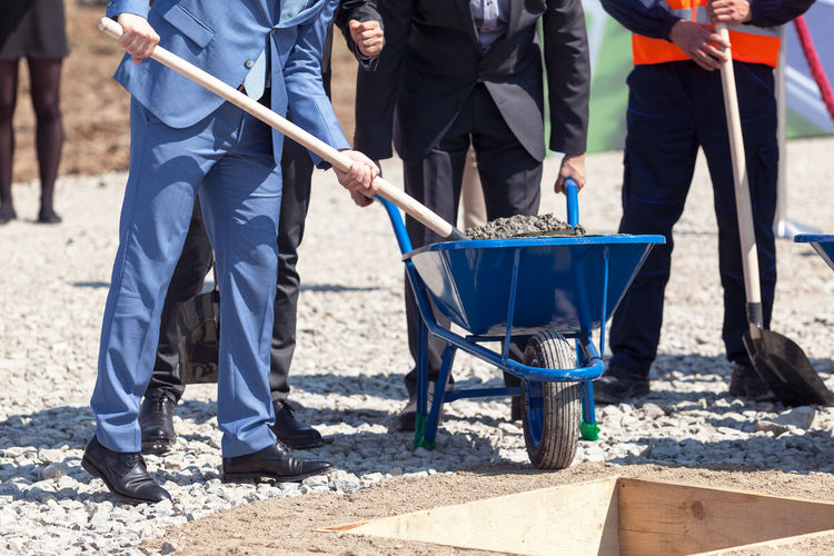 Business people at foundation stone laying ceremony for the new building Architecture Business Construction Event Foundation Work Building Businessman Businesspeople Businessperson Ceremony Constructionsite Development Financial Foundation Stone Fund Groundbreaking Investing Investment Investor Laying Manager Project Property Shovel