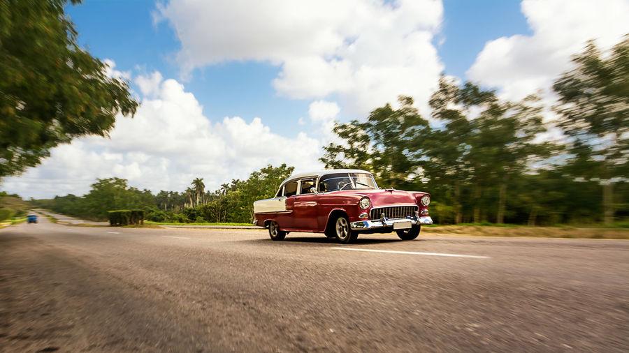 Old american classical car in highway road of Cuba Automobile Classic Car Classic Cars Classical Style Cuba Road Car Cuban Cars Highway Old Car Retro Car Retro Style Retro Styled Street Vehicle Vintage Car
