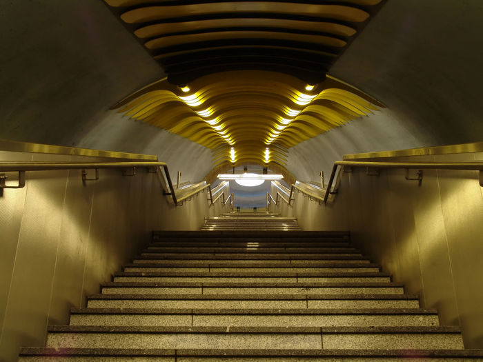 Architecture Built Structure Ceiling Diminishing Perspective Direction Empty Fluorescent Light Illuminated Indoors  Light Lighting Equipment Long Low Angle View No People Public Transportation Railing Staircase Steps And Staircases Subway Subway Station The Way Forward Transportation Tunnel Underground Walkway Underpass