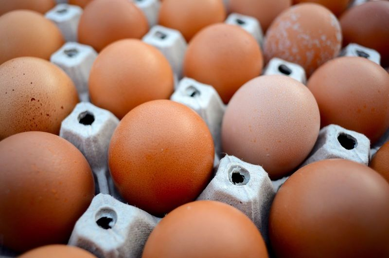 Close-Up Of Brown Eggs In Carton
