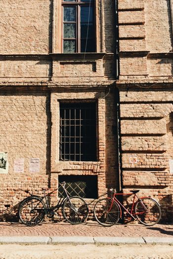 Bicycle Window Building Exterior Architecture Transportation Outdoors Mode Of Transport Day No People Built Structure Old-fashioned City Brick Wall Rustic Deterioration Italy Sunlight
