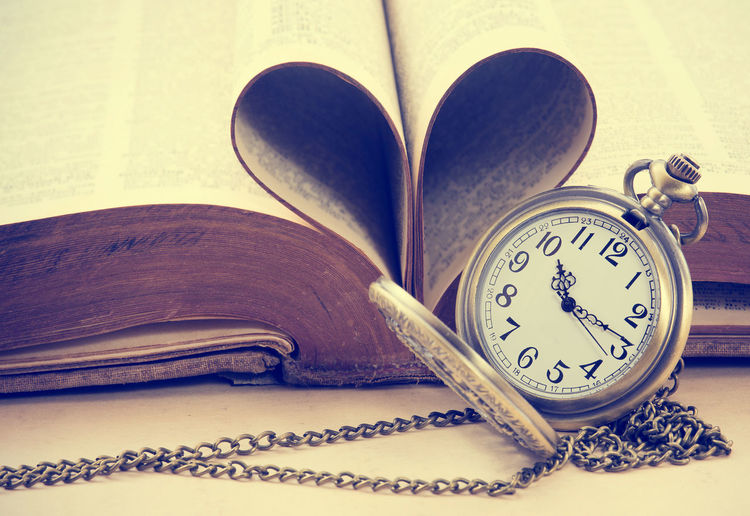 Vintage antique pocket watch and heart of the book's pages Book Clock Close-up Still Life Open Antique Time No People Instrument Of Time Pocket Watch Page Retro Styled Heart Shape Love God Bible Religion Vintage