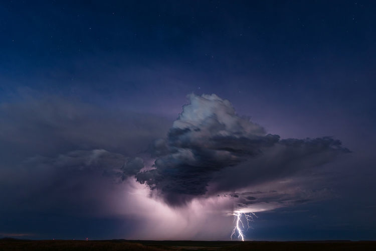 Lightning from a distant storm illuminates the night sky near buffalo, south dakota.