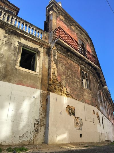 Beautiful and Broken Historic History Old Buildings Broken Beauty Lisbon - Portugal Low Angle View Architecture Built Structure Building Exterior Outdoors Clear Sky Day EyeEmNewHere EyeEmNewHere