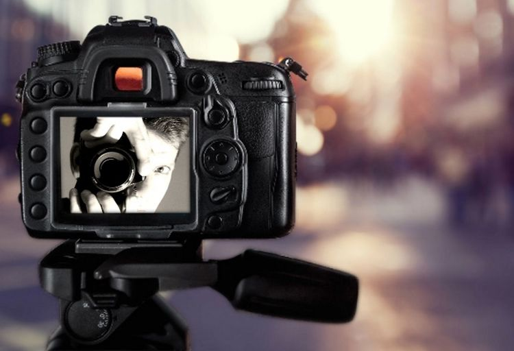 Close-up of digital camera during sunset