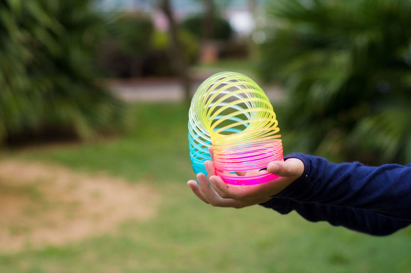 Close-up of person holding coiled toy