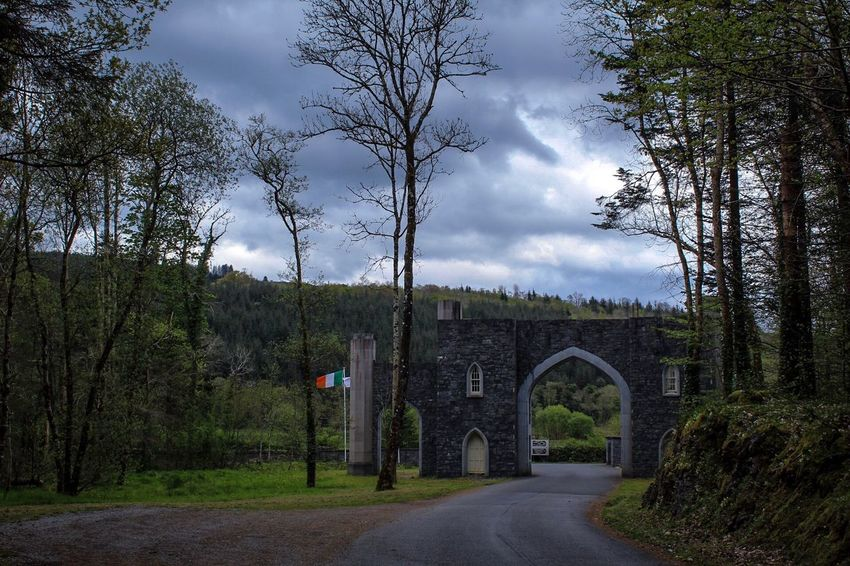 Kilronan Castle, Main Gate, Co Roscommon, Ireland, Tree Cloud - Sky Architecture Sky Arch Built Structure Day Outdoors No People The Way Forward Building Exterior Bare Tree Nature