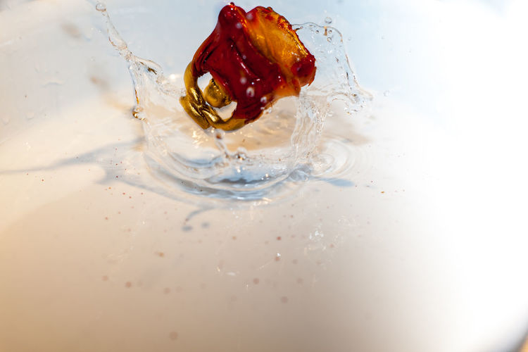 High angle view of water splashing in plate