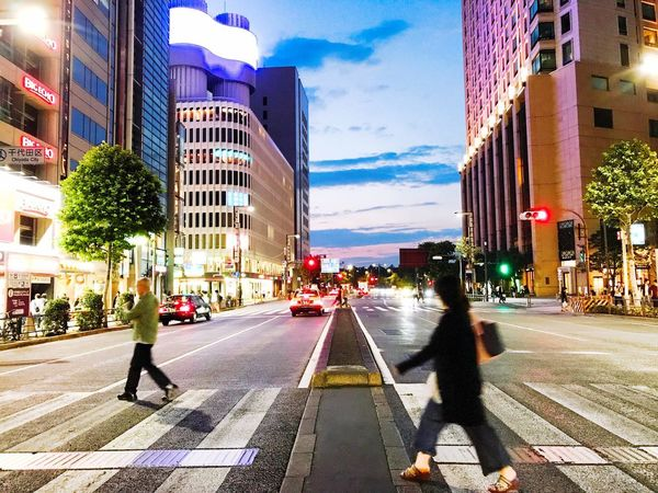 City Building Exterior Architecture Street Walking Outdoors Built Structure Illuminated Road Day Real People Sky