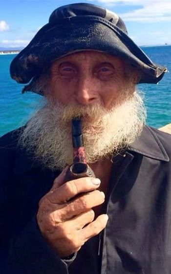 Fish sticks RePicture Masculinity Old Man Smoking A Pipe Weathered Wrinkles Portrait Fisherman