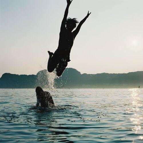 dive Dive Ocean Nature Filmcamera Japan Japanese  Film Film Photography Water Sky Motion Nature Real People Lifestyles Splashing Swimming Sea Jumping Men Adventure Waterfront