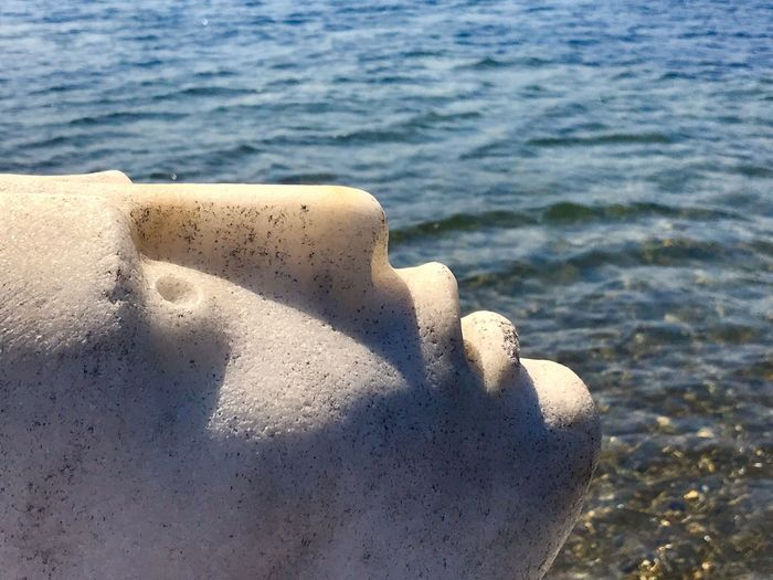 Work Of Art Statue Face Water Sea Beach Sunlight Tranquility Outdoors Focus On Foreground