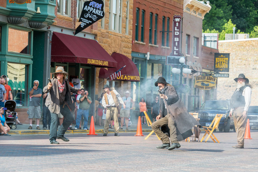 DEADWOOD, SD - AUGUST 26: Actors reenact a historic gunfight in Deadwood, SD on August 26, 2015 Actors Architecture Bar Black Hills Brick Casino Deadwood  Downtown Gunfight Guns Historic Hotel Old West  Reenactment Restaurant South Dakota Tavern  Tourism Tourists Town Travel Travel Destinations USA Western Wild West