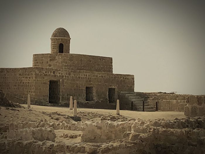 16th century fort in Bahrain Fort Bahrain Tourism Bahrain History The Past Old Ruin Built Structure Architecture Ancient Building Exterior Travel Destinations Ancient Civilization Clear Sky No People Outdoors Day Sky