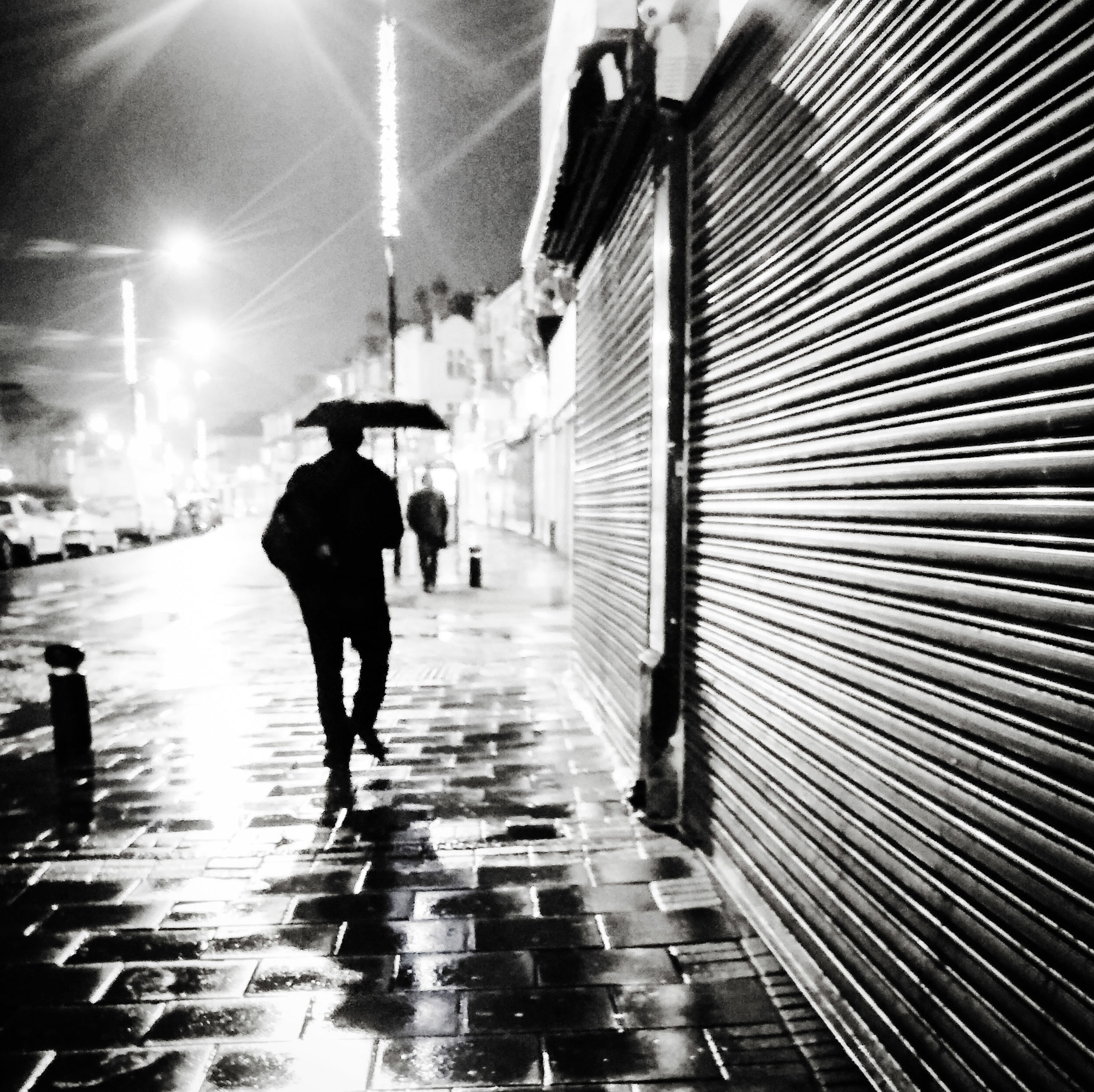 walking, full length, rear view, men, lifestyles, the way forward, person, built structure, architecture, leisure activity, street, city life, umbrella, city, diminishing perspective, building exterior, illuminated