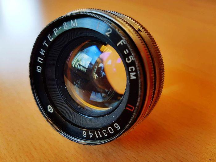 EyeEm Selects jupiter 8m camera lens Lens Camera Lens Jupiter8 Film Camera Vintage Camera Lens Reflection Indoors  Close-up Former Soviet Union Kmz