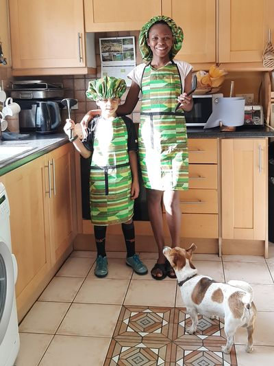 Mother, son and pet dog about to bake pear cake.