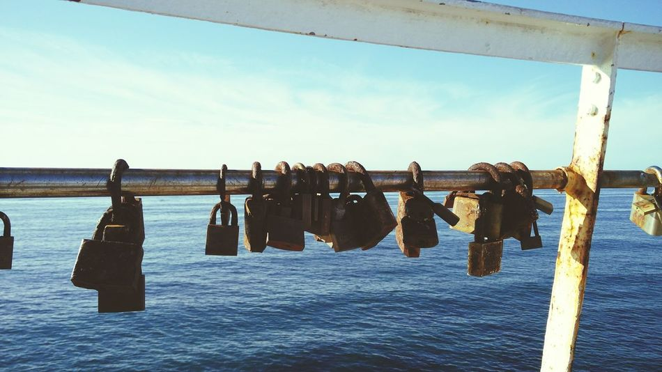 Padlocks Hanging Outdoors Sky Water Sea No People Day Horizon Over Water Asturias Spain🇪🇸 Beach Cloud - Sky The Week On EyeEm Texture And Surfaces Silhouette Tranquil Scene