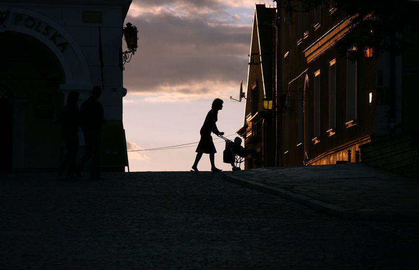 Architecture Mother Sandomierz Silhouette Silhouettes Strolling Architecture Building Child Full Length Leisure Activity Lifestyles Men People Real People Stroller Togetherness Two People Walking