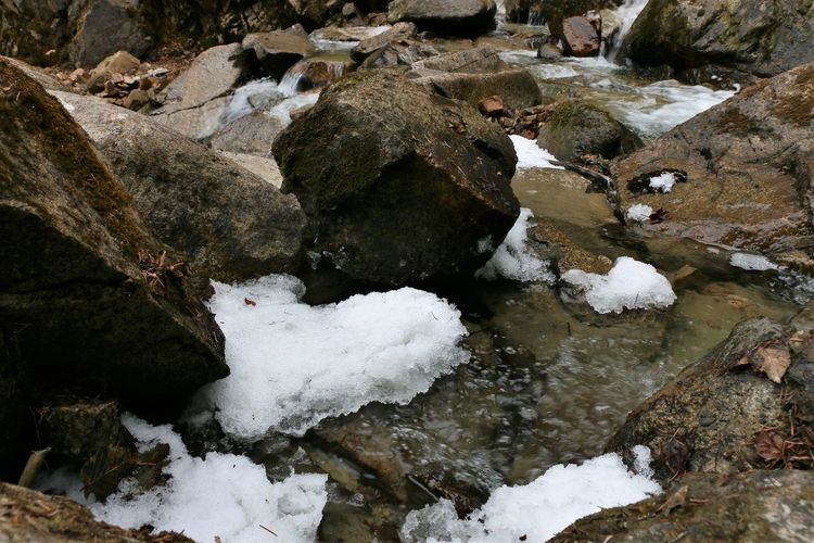 Snow in creek of Lower Reid Falls, Skagway, Alaska Snow Cold Temperature Winter Water White Color Nature No People Day High Angle View Beauty In Nature Solid Covering Rock Frozen Rock - Object Outdoors Tranquility Lake Flowing Water Skagway Alaska