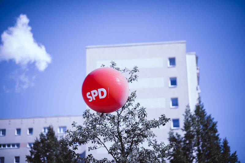 SozialdemokratischePar Architecture Balloon Blue Building Building Exterior Built Structure Celebration Communication Day Die Linke Growth Helium Balloon Low Angle View Nature No People Outdoors Plant Red Sky Socialism Sozialdemokratie Spd Text Tree