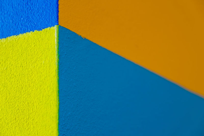 Abstract geometric pattern on concrete wall Architecture Backgrounds Blue Building Exterior Built Structure Close-up Copy Space Day Full Frame High Angle View Multi Colored No People Orange Color Outdoors Pattern Textured  Vibrant Color Wall - Building Feature Yellow