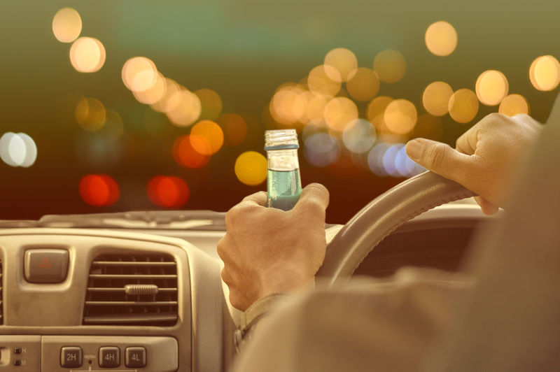 Drunk and driving Human Hand Hand Human Body Part Mode Of Transportation Technology Communication One Person Lifestyles Car Holding Motor Vehicle Transportation Real People Wireless Technology Close-up Selective Focus Illuminated Indoors  Men Finger