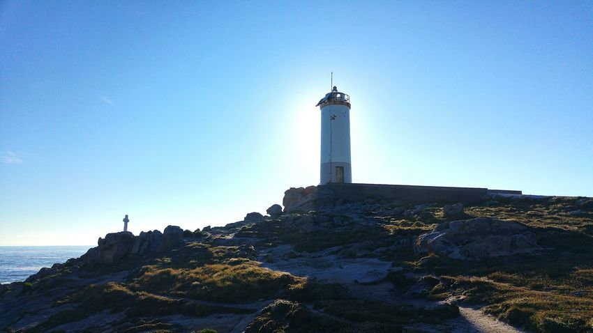 Lighthouse History Sky Travel Destinations Landscape Architecture Building Exterior Day Tranquility Outdoors Beach Statue No People Blue Scenics Sunset Nature Illuminated Clear Sky Horizon Faro Roncudo Galicia, Spain Sunset_collection Cross